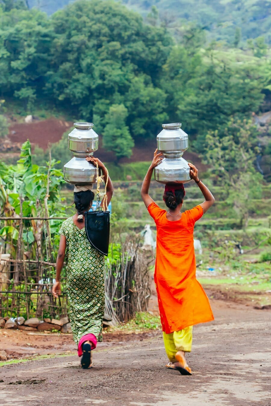 Villagers carrying water in an Indian village